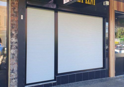 Shopfront Roller Shutter Job 2 White Modern Shutters - Roller Shutter People